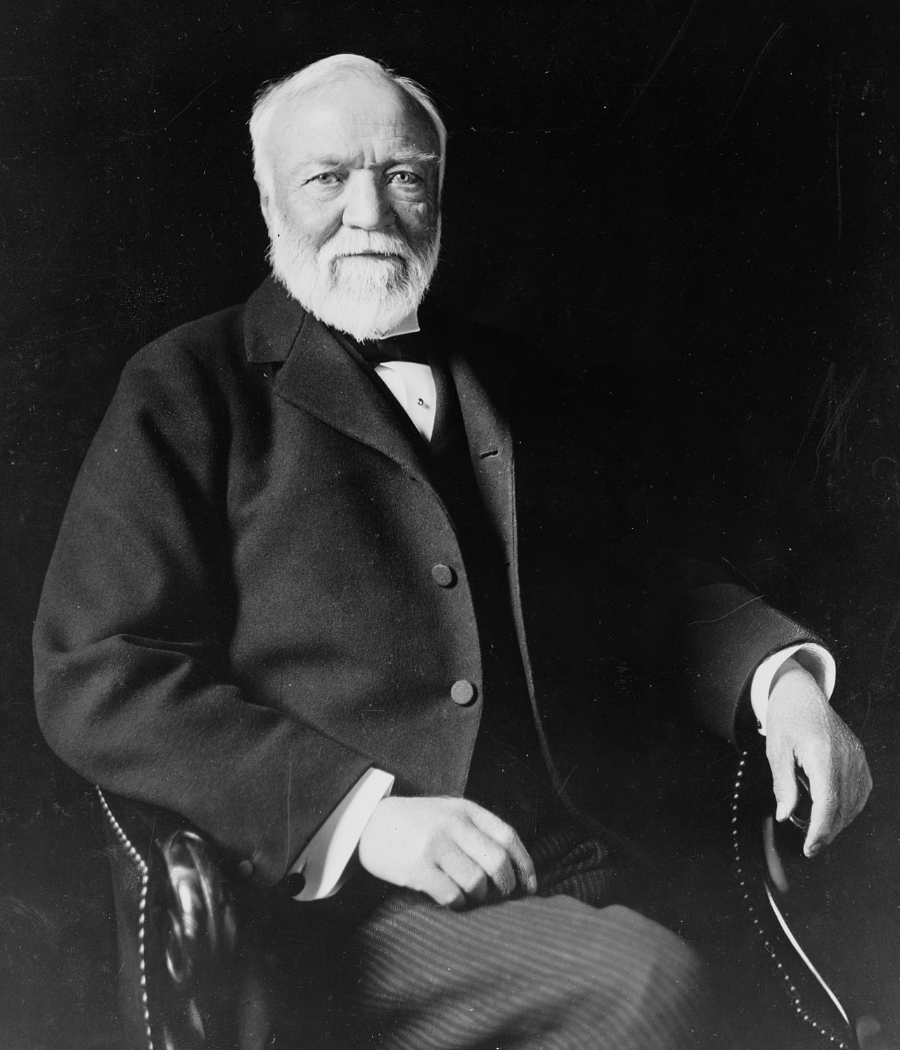 1280px-Andrew_Carnegie,_three-quarter_length_portrait,_seated,_facing_slightly_left,_1913.jpg